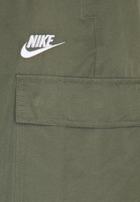 Nike Sportswear - Pantaloni sportivi - twilight marsh/white - 6