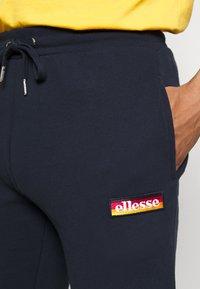 Ellesse - YONVEST - Tracksuit bottoms - navy - 4