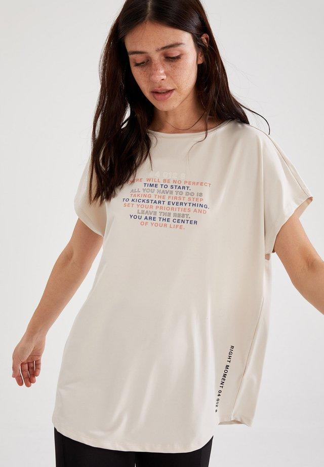 Camiseta estampada - beige