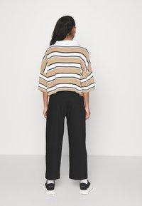 Weekday - JINA TROUSER - Trousers - black dark - 2