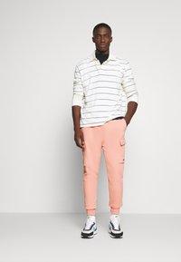 Nike Sportswear - PANT CARGO - Tracksuit bottoms - pink quartz - 1