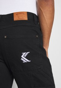 Karl Kani - RINSE PANTS - Jeans relaxed fit - black - 4