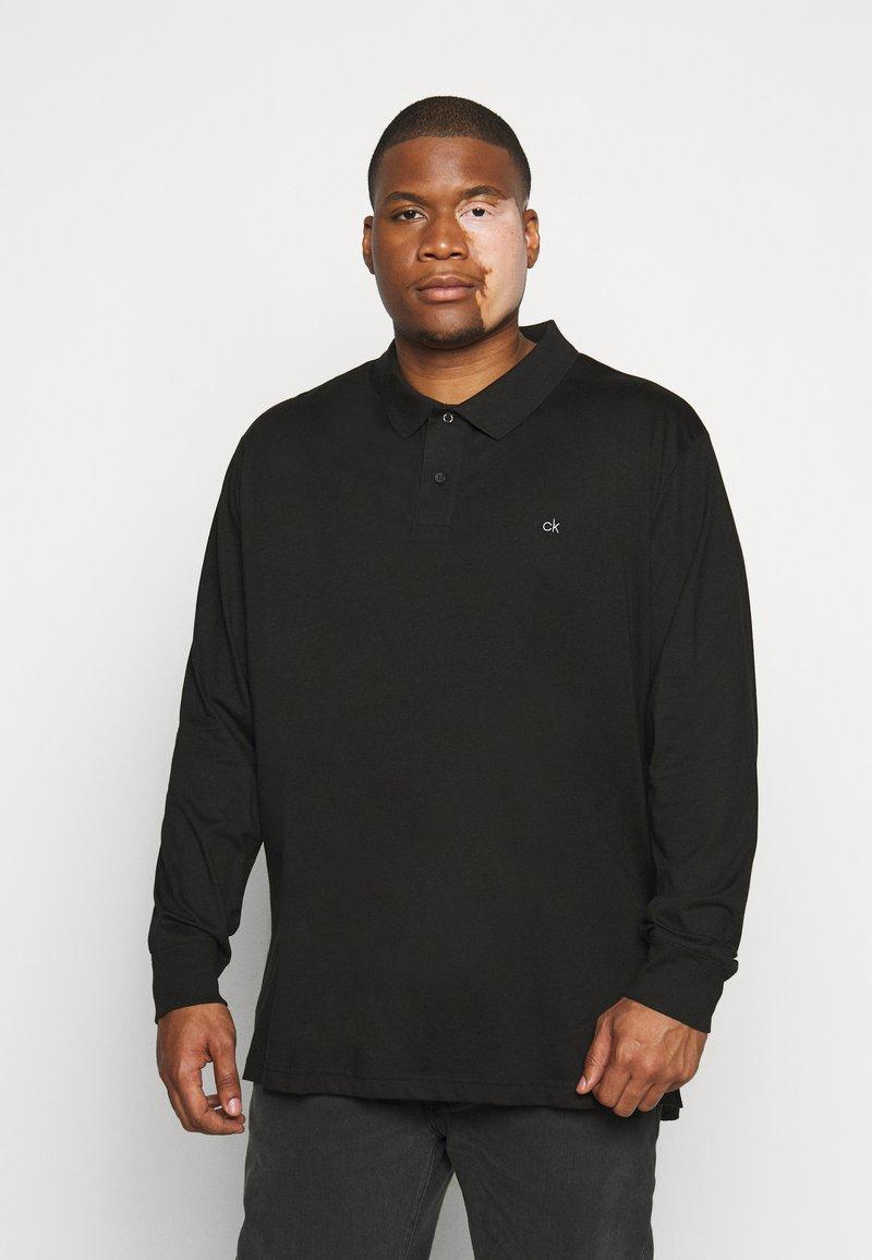 Calvin Klein - LIQUID TOUCH LONG SLEEVE - Polo shirt - black
