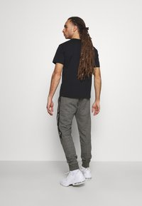 Champion - TAPE PANTS - Tracksuit bottoms - black/dark grey melange - 2