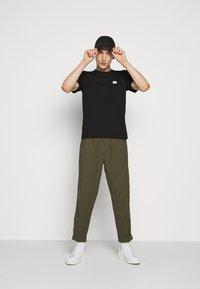 C.P. Company - SHORT SLEEVE - Basic T-shirt - black - 1