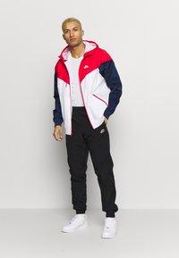 Nike Sportswear - PANT SIGNATURE - Teplákové kalhoty - black - 1