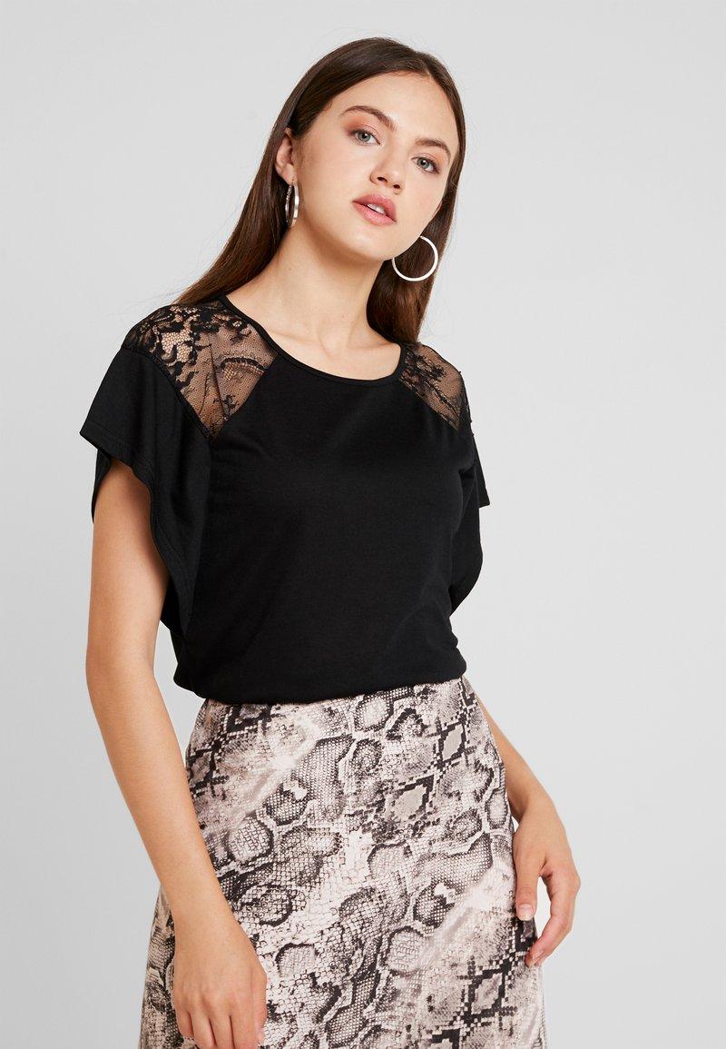 Vero Moda - VMKASANDRA  - T-shirt imprimé - black
