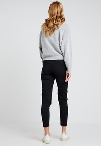 ONLY - ONLSTRIKE  - Trousers - black - 2