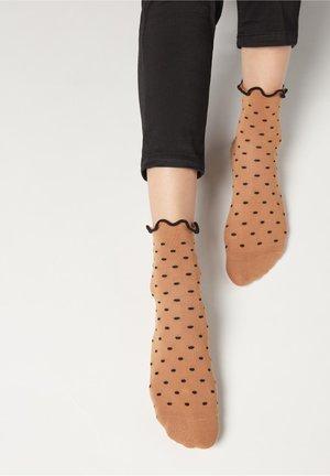 MIT ANIMALMUSTER - Socks - abisso