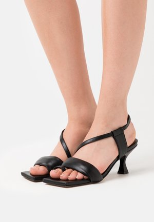 ASYMETHRIC STRAPS - Sandals - black
