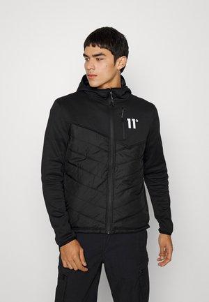 TREK HYBRID JACKET - Light jacket - black