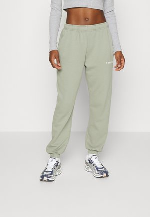 DARI PANTS WOMEN - Pantalon de survêtement - olive