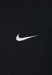 Nike Performance - ISSUE HOODIE - Zip-up sweatshirt - black/pale ivory - 7