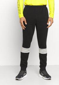 adidas Performance - COLORBLOCK ESSENTIALS - Tracksuit bottoms - black/medium grey heather - 0