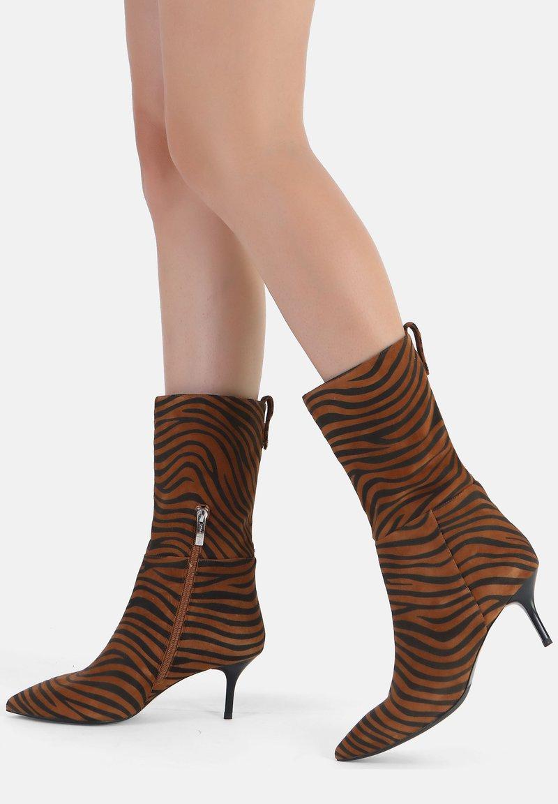 Ekonika - Ankle boots - zebra-spice
