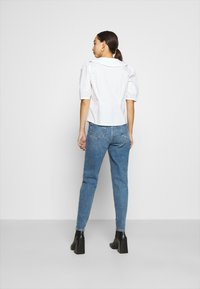 Monki - SANDRA BLOUSE - Button-down blouse - white - 2