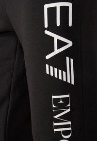 EA7 Emporio Armani - PANTALONI - Tracksuit bottoms - black - 4