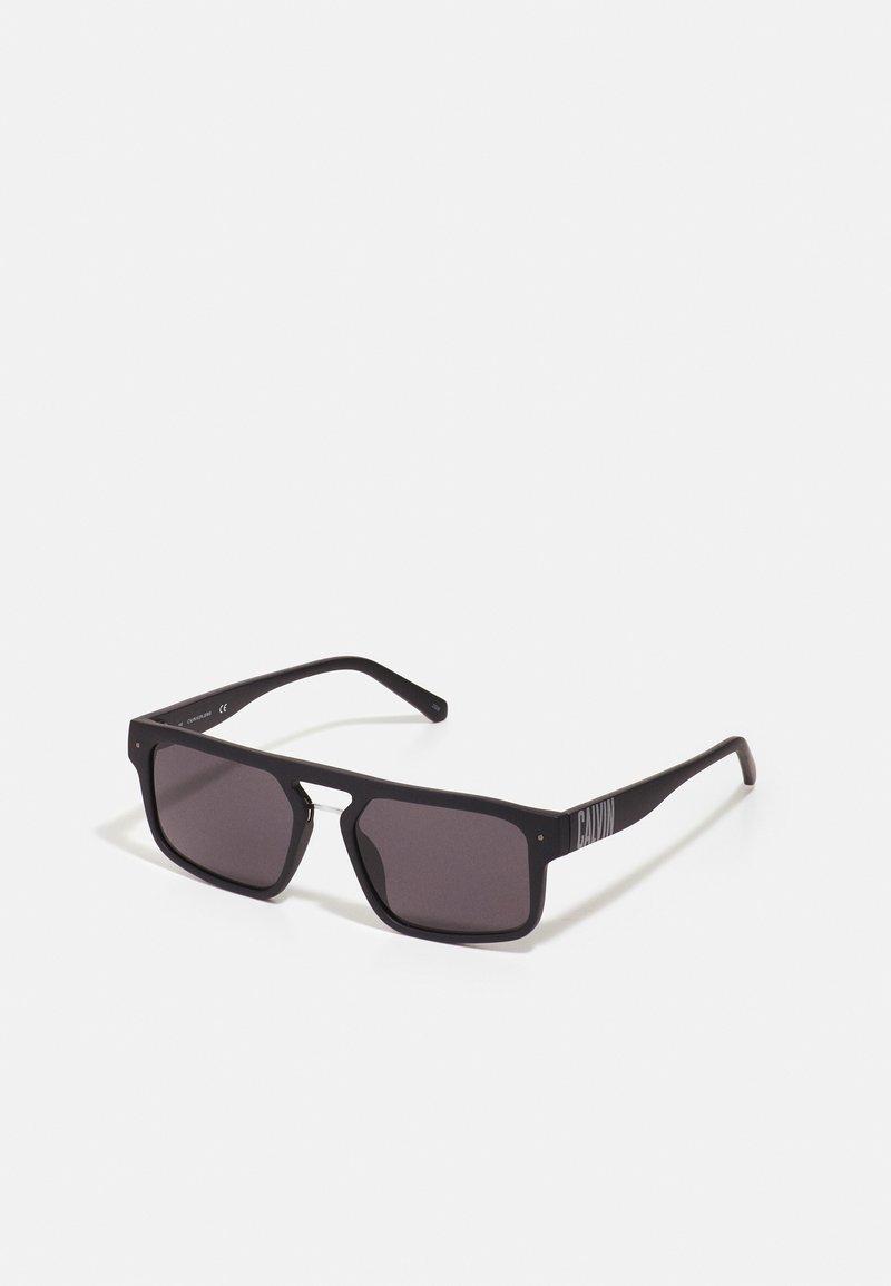 Calvin Klein Jeans - UNISEX - Sunglasses - matte black
