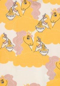 Mini Rodini - UNICORN NOODLES UNISEX - Print T-shirt - yellow - 2