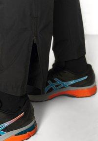 ASICS - CORE PANT - Tracksuit bottoms - performance black - 3