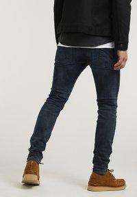 CHASIN' - EGO TRESS - Slim fit jeans - dark blue - 1