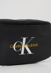 Calvin Klein Jeans - COATED ROUND STREET PACK - Bum bag - black - 7