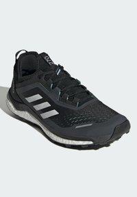adidas Performance - TERREX AGRAVIC FLOW SCHUH - Nøytrale løpesko - black - 1