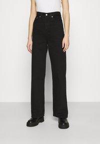 Levi's® - HIGH LOOSE - Jean flare - black denim - 0