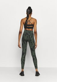 Casall - ICONIC PRINTED 7/8 - Tights - survive dark green - 2
