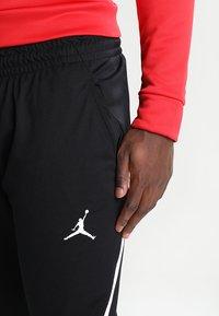 Jordan - ALPHA DRY PANT - Jogginghose - black/white - 3