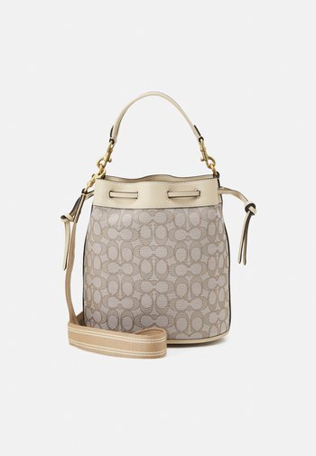 SIGNATURE FIELD BUCKET BAG - Handbag - stone ivory