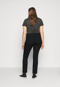 Vero Moda Curve - VMMANYA  - Slim fit jeans - black - 2