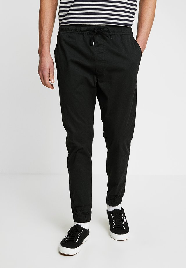TRUC CUFF - Trousers - black