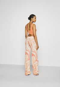 Jaded London - RUCHED JOGGERS SWIRL - Trousers - orange/off-white - 2