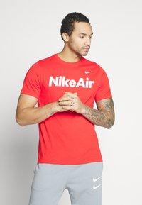 Nike Sportswear - AIR TEE - Print T-shirt - university red/white - 0