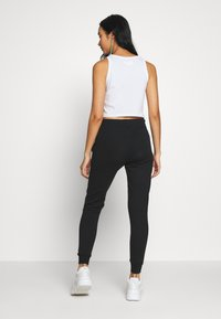 Diesel - VICTADIA TROUSERS - Tracksuit bottoms - black - 2