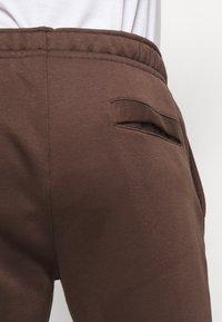 Nike Sportswear - CLUB - Tracksuit bottoms - baroque brown - 5