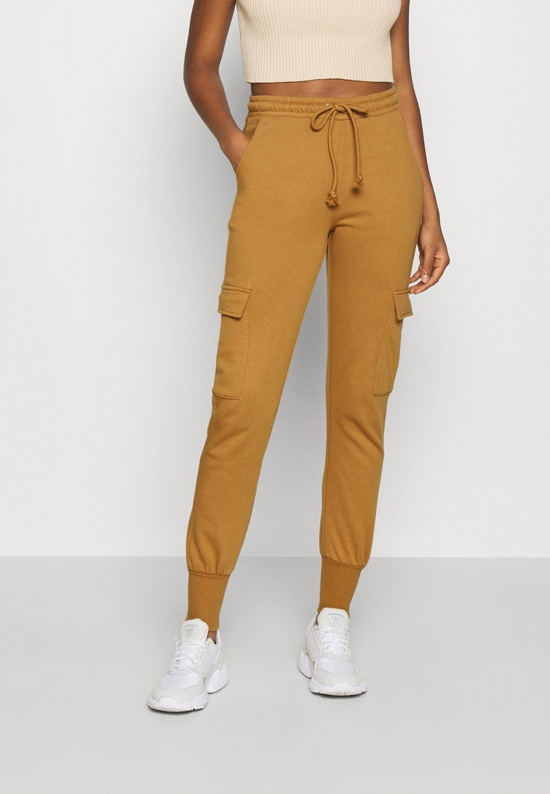 Vero Moda - VMMERCY PANT - Tracksuit bottoms - tobacco brown