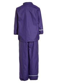 CeLaVi - RAINWEAR SUIT BASIC SET WITH FLEECE LINING - Rain trousers - purple - 2