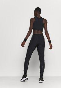 Nike Performance - RUN PANT - Pantalones deportivos - black/grey fog/white - 2