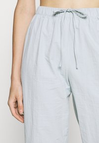Missguided - TIE CUFF - Tracksuit bottoms - baby blue - 3