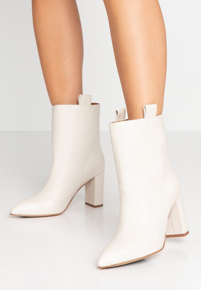 High heeled ankle boots - offwhite