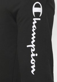 Champion - LEGACY CUFF PANTS - Tracksuit bottoms - black - 4