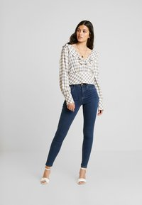 Gina Tricot - MOLLY HIGHWAIST - Jeans Skinny Fit - rinsed denim - 1