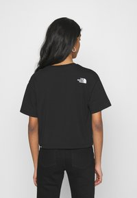 The North Face - CROPPED FINE TEE - T-shirts med print - black - 2