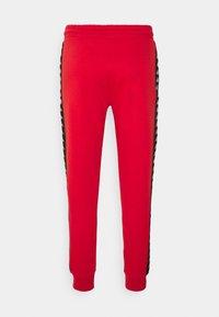 Kappa - Tracksuit bottoms - aurora red - 1