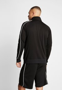 Hummel - ARNE ZIP JACKET - Training jacket - black - 2