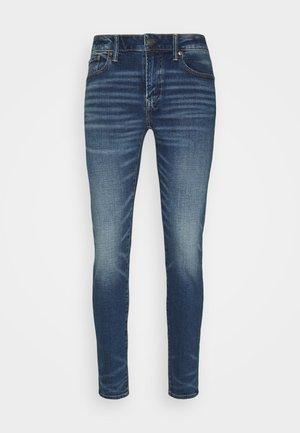 Skinny džíny - worn out blue