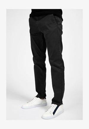 Trousers - mehrfarbig schwarz