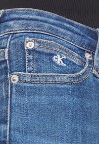 Calvin Klein Jeans - SUPER SKINNY - Jeans Skinny Fit - mid blue - 4
